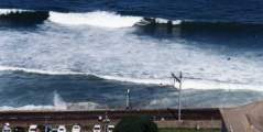 surfers on wave at St James