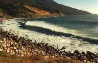 Atlantic waves breaking on Oudekraal pebble beach